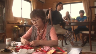grandma is busy sewing