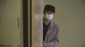 the surgical mask makes him more suspicious
